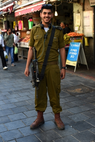 "Nati Drai, 20, if Beersheba, poses for a portrait in Mahane Yehuda in Jerusalem, Israel. ""It means home, the capitol, the heart of Israel"" said Drai of Jerusalem."