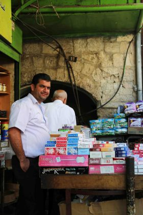 """ I live here in Jerusalem because it's a holy place. The Jews would give me a blank check for my house and store, but I will never leave. Only if they kill me."" On the eve of Ramadan, the holy month for Muslims, who will fast from sunrise to sunset, the streets of the Old City of Eastern Jerusalem were busy. Palestinian Muslims were shopping for the traditional food that they will eat when they break fast."