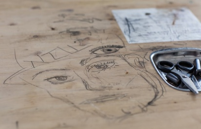 Artists sketch as they work in the Beita space